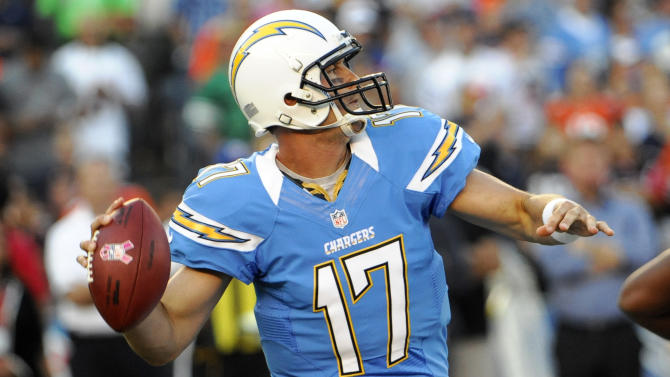 San Diego Chargers quarterback Philip Rivers throws a pass against the Denver Broncos during the first half of an NFL football game, Monday, Oct. 15, 2012, in San Diego. (AP Photo/Denis Poroy)