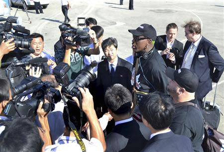Former NBA basketball star Dennis Rodman speaks the media after arriving at an airport in Pyongyang