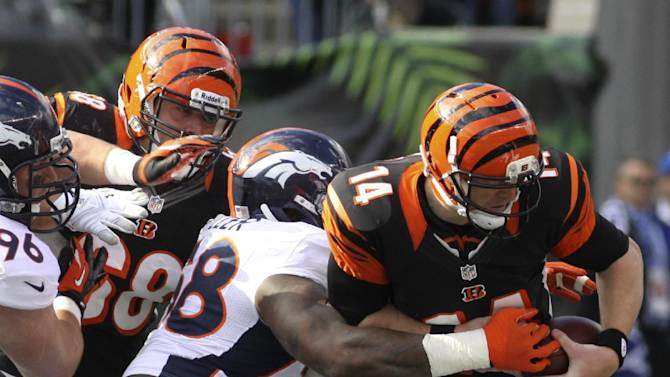 Cincinnati Bengals quarterback Andy Dalton (14) is sacked by Denver Broncos outside linebacker Von Miller (58) in the first half of an NFL football game, Sunday, Nov. 4, 2012, in Cincinnati. (AP Photo/Tom Uhlman)