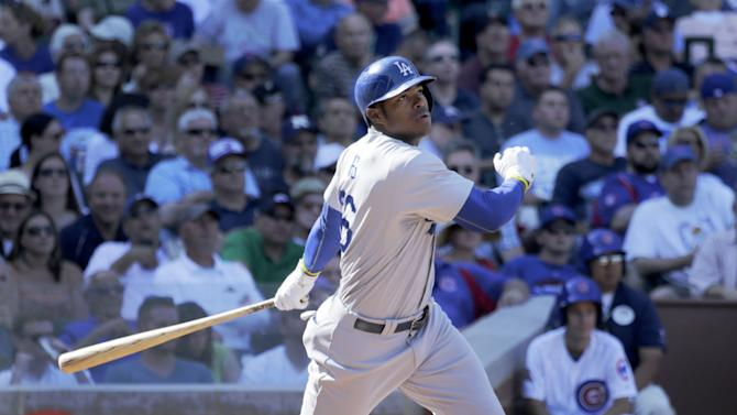 Los Angeles Dodgers' Yasiel Puig doubles off a pitch from Chicago Cubs relief pitcher Eric Jokisch, during the fourth inning of a baseball game Friday, Sept. 19, 2014, in Chicago. (AP Photo/Charles Rex Arbogast)