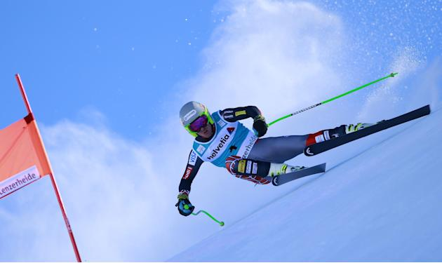 Ted Ligety of the United States,  speeds on his way to take second place in a men's alpine skiing downhill at the World Cup finals in Lenzerheide, Switzerland, Wednesday, March 12, 2013