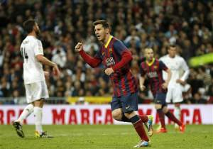 Barcelona's Lionel Messi celebrates after scoring a penalty against Real Madrid during La Liga's second 'classic' soccer match of the season at Santiago Bernabeu stadium in Madrid