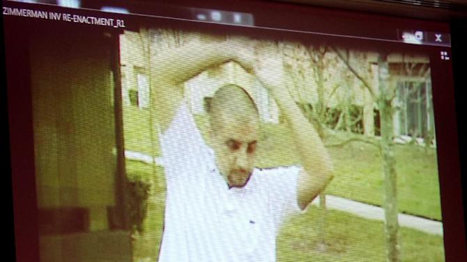 A reenactment video shows George Zimmerman with Sanford police investigators, taken the after the Trayvon Martin shooting, is projected for the jury during the 16th day of his trial in Seminole circuit court, in Sanford, Fla., Monday, July 1, 2013. Zimmerman has been charged with second-degree murder for the 2012 shooting death of Trayvon Martin.(AP Photo/Orlando Sentinel, Joe Burbank, Pool)