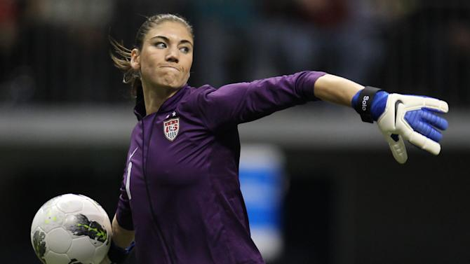 United States goalkeeper Hope Solo (1) clears the ball from in front of her net during the second half against Costa Rica at the CONCACAF women's Olympic qualifying soccer game action at B.C. Place in Vancouver, British Columbia, Friday, Jan. 27, 2012. (AP Photo/The Canadian Press, Jonathan Hayward)