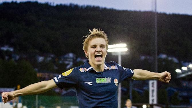 FILE - In this undated but recent file photo showing 15-year old soccer player Martin Odegaard in action in Drammen, Norway, who has been selected for Norway's national soccer team, becoming Norway's youngest player ever in the national football team. Midfielder Odegaard who plays with Norwegian club Stromsgodset, is selected by Norway for the country's upcoming friendly against the United Arab Emirates on Aug. 27. (AP Photo / Vegard Wivestad Grott, NTB scanpix) NORWAY OUT