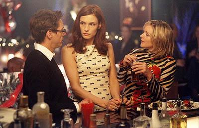 "Larry (Robert Downey Jr., L) gets a Christmas surprise when his ex-girlfriend/mother of his child Jamie (guest star Famke Janssen, C) comes to town, naturally, Elaine (Jane Krakowski R) gets involved, on ""The Man With The Bag"" episode of Ally McBeal Ally McBeal"