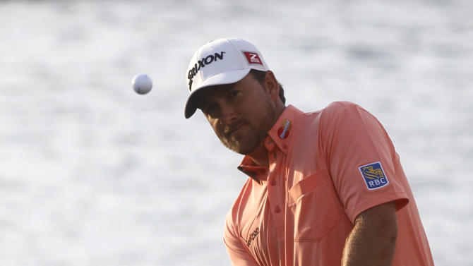 Graeme McDowell, of Northern Ireland, hits from the rough on the 18th holde during the final round of the Cadillac Championship golf tournament on Sunday, March 10, 2013, in Doral, Fla. (AP Photo/Marta Lavandier)