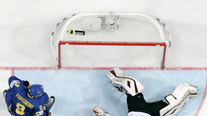 Latvia's goaltender Masalskis reacts after a goal of Sweden's Forsberg during their Ice Hockey World Championship game at the O2 arena in Prague