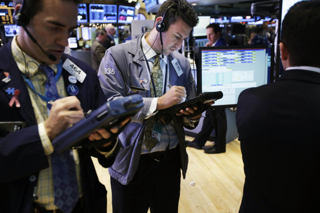 Traders work on the floor at the New York Stock Exchange in New York, Friday, Dec. 28, 2012. Stocks were heading lower Friday, for a fifth day, on concern that Washington lawmakers will fail to reach a budget deal before a year-end deadline. (AP Photo/Seth Wenig)