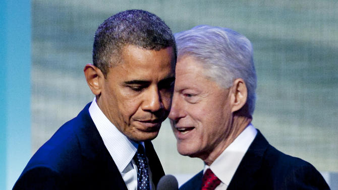 President Barack Obama steps to the microphone after being introduced by former President Bill Clinton, Tuesday, Sept. 25, 2012, at the Clinton Global Initiative in New York. (AP Photo/Mark Lennihan)