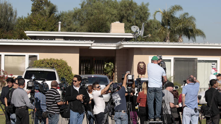 Media gather outside the home of singer Jenni Rivera's mother in Lakewood, Calif. Monday, Dec. 10, 2012. Rivera died Sunday in a plane crash in Mexico. U.S. authorities confirmed Monday that Jenni Rivera, a U.S.-born singer whose soulful voice and openness about her personal troubles made her a Mexican-American superstar, was killed Sunday in a plane crash in northern Mexico. (AP Photo/Jason Redmond)