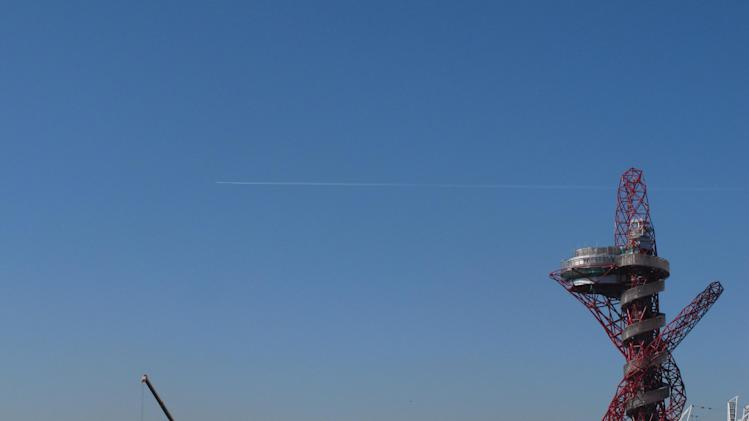 A plane flies past the Olympic Park in London on Monday, March 19, 2012. Those responsible for the British capital's network of fiber optic cables, phone masts and wifi hotspots say they're bracing for a data deluge as the games get underway. (AP Photo/Raphael Satter)