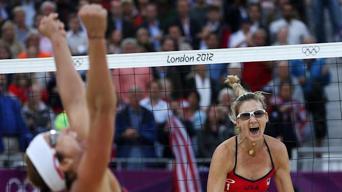 FILE - In this Aug. 7, 2012 file photo, United States' Misty May-Treanor, left, and Kerri Walsh Jennings celebrate after defeating China in their semifinal women's beach volleyball match at the 2012 Summer Olympics, in London. (AP Photo/Petr David Josek, File)