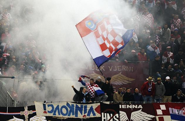 Croatian soccer fans light flares during a friendly soccer match between Switzerland and Croatia at the AFG Arena in St. Gallen, Switzerland, Wednesday, March 5, 2014