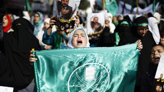 Protesters from the Islamic Action Front take part in a demonstration in Amman
