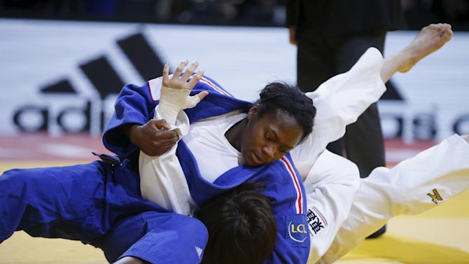 France's Agbegnenou challenges Tashiro in their women's under 63kg final match at the Paris International Grand Slam judo tournament