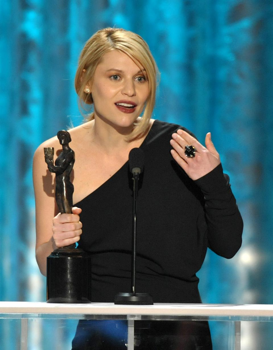 "Claire Danes accepts the award for outstanding female actor in a drama series for ""Homeland"" at the 19th Annual Screen Actors Guild Awards at the Shrine Auditorium in Los Angeles on Sunday Jan. 27, 2013. (Photo by John Shearer/Invision/AP)"