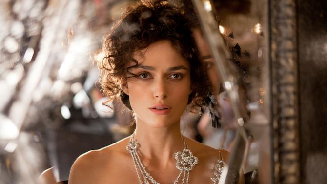 "FILE - This publicity film image released by Focus Features shows Keira Knightley in a scene from ""Anna Karenina."" While ""Pride & Prejudice"" and ""Atonement"" were fresh, lively takes for an age that finds costume drama stuffy, director Joe Wright planned a wild and possibly off-putting ride on ""Anna Karenina,"" confining most of the action to a dilapidated theater where the actors would perform in a stylized cinematic ballet without the usual grand sweep of period-drama locations. (AP Photo/Focus Features, Laurie Sparham, File)"