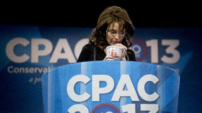 Former Alaska Gov. Sarah Palin drinks from a 7-Eleven Super Big Gulp on stage while speaking at the 40th annual Conservative Political Action Conference in National Harbor, Md., Saturday, March 16, 2013. Earlier in the week a New York judge struck down a ban proposed by New York Mayor Michael Bloomberg to end the sale of sugared sodas larger than 16 oz. (AP Photo/Carolyn Kaster)