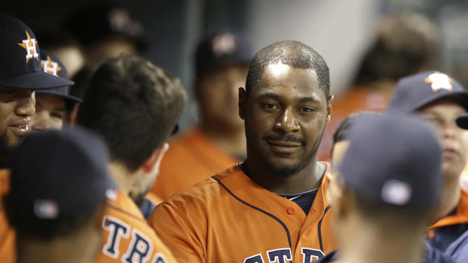 Carter and Grossman lead Astros over Rangers 4-3