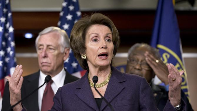 "House Minority Leader Nancy Pelosi, D-Calif., meets with reporters about the fiscal cliff negotiations at the Capitol in Washington, Friday, Dec. 21, 2012. She is joined by House Minority Whip Steny Hoyer, D-Md., left, and Assistant Minority Leader James Clyburn, D-S.C., right. Hopes for avoiding the ""fiscal cliff"" that threatens the U.S. economy fell Friday after fighting among congressional Republicans cast doubt on whether any deal reached with President Barack Obama could win approval ahead of automatic tax increases and deep spending cuts kick in Jan. 1.  (AP Photo/J. Scott Applewhite)"