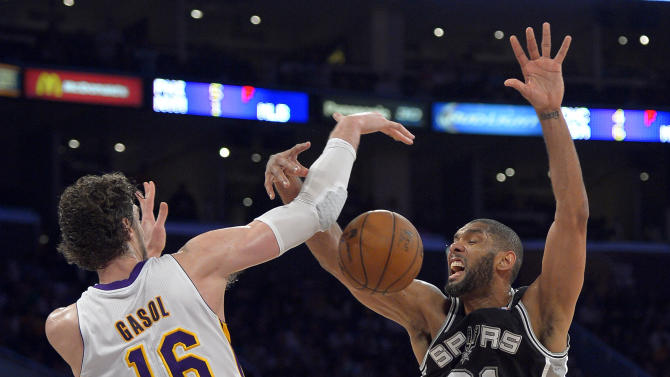 Los Angeles Lakers forward Pau Gasol (16), of Spain, knocks the ball out of the hands of San Antonio Spurs forward Tim Duncan during the second half in Game 4 of a first-round NBA basketball playoff series, Sunday, April 28, 2013, in Los Angeles. The Spurs won 103-82. (AP Photo/Mark J. Terrill)