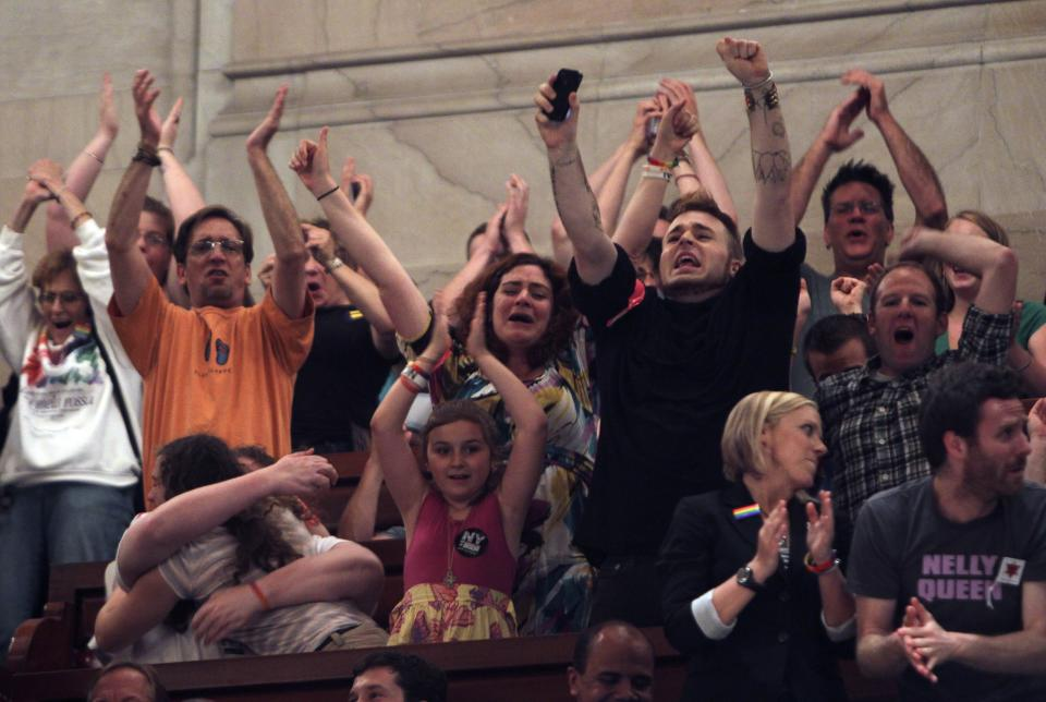 People in the Senate gallery react to the passage of gay marriage at the Capitol in Albany, N.Y., on Friday, June 24, 2011.  (AP Photo/Mike Groll)
