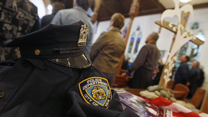 A uniform from the NYPD is displayed  during a special service to commemorate the 10th anniversary of the Sept. 11 terrorist attacks, at a church in New Plymouth, New Zealand, Sunday, Sept. 11, 2011. The US team will play Ireland in their opening Rugby World Cup game later today.  (AP Photo/Dita Alangkara)