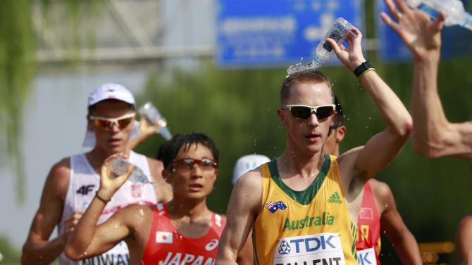 Jared Tallent of Australia (R) competes in the men's 50 km race walk final during the 15th IAAF World Championships at the National Stadium in Beijing