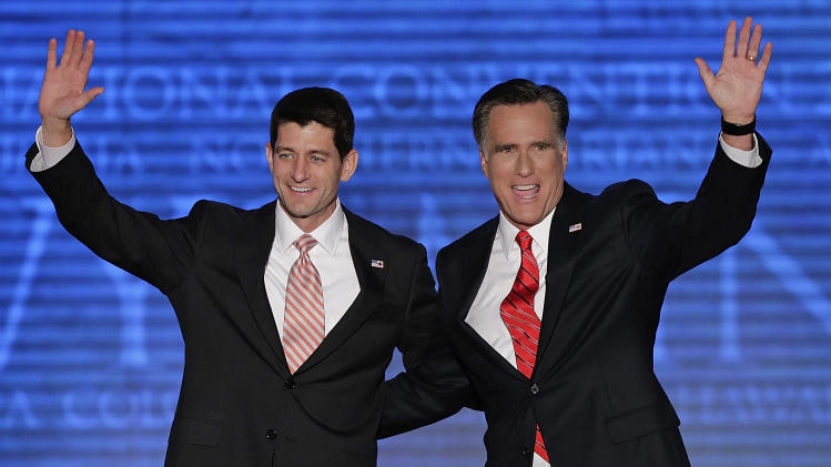 Republican vice presidential nominee, Rep. Paul Ryan and presidential nominee Mitt Romney wave to the delegates during the Republican National Convention in Tampa, Fla., on Thursday, Aug. 30, 2012. (AP Photo/J. Scott Applewhite)