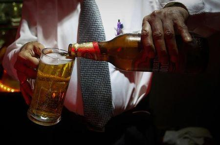A bartender pours Haywards 5000 strong beer, a product of SABMiller, into a glass at a restaurant in Mumbai