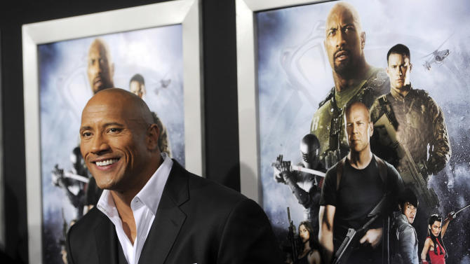 """Dwayne Johnson, a cast member in """"G.I. Joe: Retaliation,"""" poses at the Los Angeles premiere of the film at the TCL Chinese Theatre on Thursday, March 28, 2013 in Los Angeles. (Photo by Chris Pizzello/Invision/AP)"""