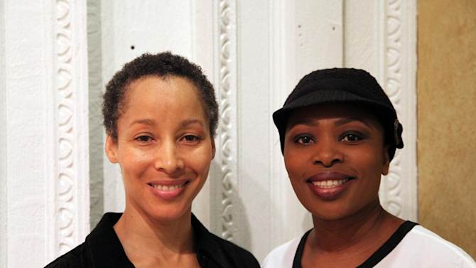 """In this Nov. 8, 2012, photo, dancer Camille N. Brown, left, and singer Lindiwe Dlamini pose before a performance of """"The Lion King"""" in New York. Both women have been in the ensemble of the Broadway hit show for its entire 15-year run. (AP Photo/Mark Kennedy)"""