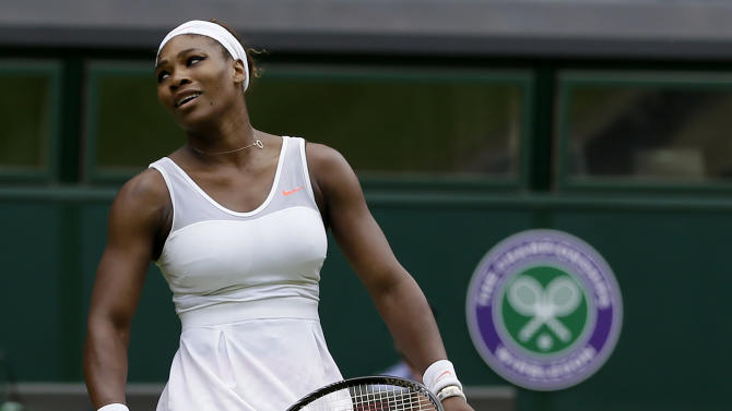 Serena Williams of the United States reacts during her match against Sabine Lisicki of Germany in a Women's singles at the All England Lawn Tennis Championships in Wimbledon, London, Monday, July 1, 2013. (AP Photo/Alastair Grant)