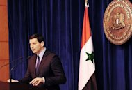 A picture released by the official Syrian Arab News Agency shows Syria's Foreign Ministry Spokesman Jihad Makdissi addressing a news conference in Damascus. Syria admitted Monday it has chemical weapons and warned of using them if attacked, though not against its own civilians, as regime troops reclaimed most of Damascus after a week of heavy clashes