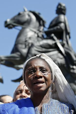 Minister of Culture of Mali Fadima Toure Diallo appeals for the preservation of heritage in Mali, in St. Petersburg, Russia, Tuesday, July 3, 2012, with one of the city landmarks, equestrian statue of Peter the Great, seen in the background. Muslim extremists continued destroying the heritage of the ancient Malian city of Timbuktu on Monday, razing tombs and attacking the gate of a 600-year-old mosque, despite growing international outcry.The International Criminal Court has described the destruction of the city's patrimony as a possible war crime, while UNESCO's committee on world heritage was holding a special session this week to address the pillaging of the site, one of the few cultural sites in sub-Saharan Africa. (AP Photo/Dmitry Lovetsky)