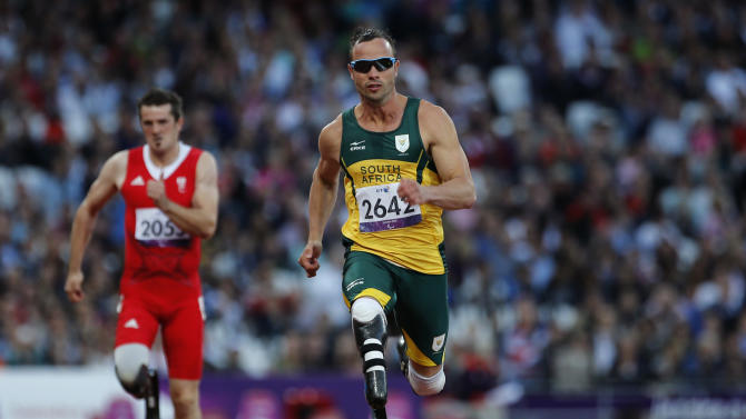 "FILE  - In this Wednesday, Sept. 5, 2012 file photo, South Africa's Oscar Pistorius competes during Men's 100m T44 round 1 at the 2012 Paralympics in London. Olympic sprinter Oscar Pistorius has been arrested after a 30-year-old woman was shot dead at his home in South Africa. Police say Pistorius, a double-amputee known as ""Blade Runner,"" was taken into custody after the shooting early Thursday,  Feb. 14, 2013,  at his home in a gated complex in the country's capital. (AP Photo/Emilio Morenatti, File)"