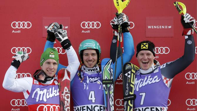 From left: Second placed Marcel Hirscher of Austria, winner Felix Neureuther of Germany and third placed Ivica Kostelic of Croatiacelebrate on the podium after the alpine skiing World Cup slalom race at the Lauberhorn in Wengen, Switzerland, Sunday, Jan. 20, 2013. (AP Photo/Keystone, Peter Klaunzer)