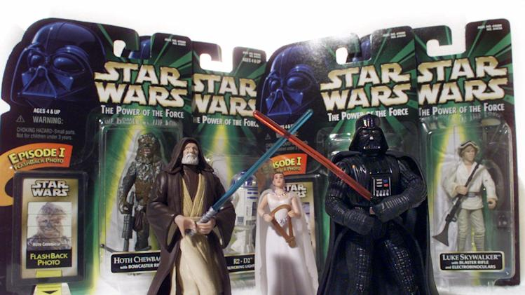 "FILE - ""Star Wars"" action figures Darth Vader, right, and Ben (Obi-Wan) Kenobi, left, are displayed in this April 7, 1999 file photo, with Princess Leia Organa in her ceremonial dress in front of other packaged characters from the new film. The National Toy Hall of Fame announces its class of 2012 Thursday Nov. 15, 2012. Two toys will be inducted into the Rochester hall from among 12 nominees. (AP Photo/ Victoria Arocho, File)"