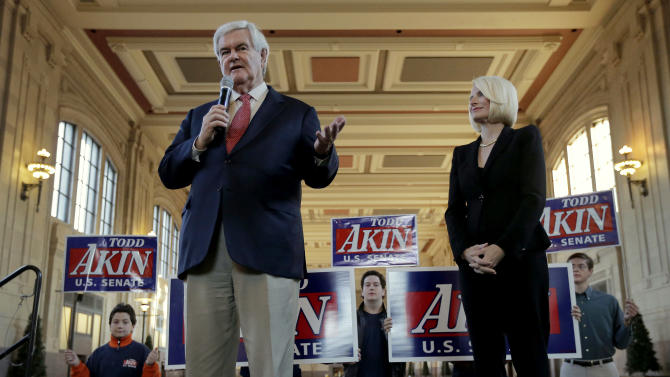 Former Republican presidential hopeful Newt Gingrich and his wife, Callista, appear at a campaign stop for Missouri Senate candidate Rep. Todd Akin, R-Mo., at Union Station, Wednesday, Oct. 31, 2012, in Kansas City, Mo. (AP Photo/Charlie Riedel)