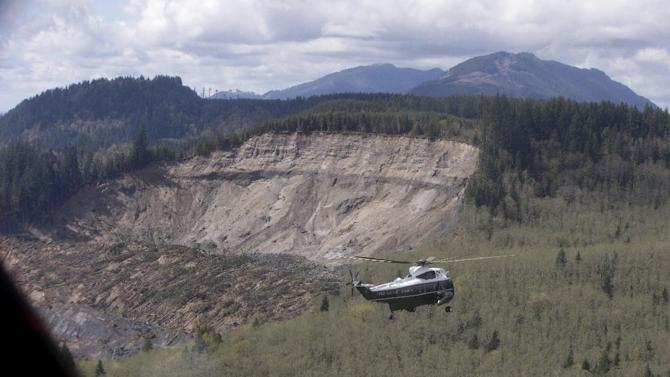 Marine One, carrying President Barack Obama, takes an aerial tour of Oso, Wash., Tuesday, April 22, 2014, the site of the deadly mudslide that struck the community in March. (AP Photo/Carolyn Kaster, Pool)