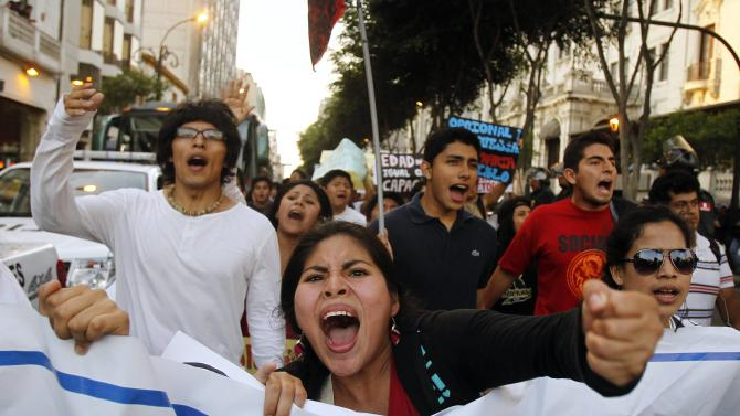 Protesters shout slogans as they march against the government in Lima