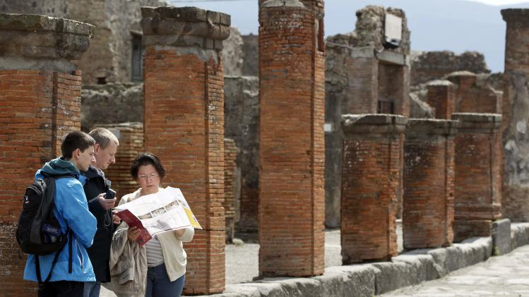People visit the ruins at the ancient archaeological site of Pompeii