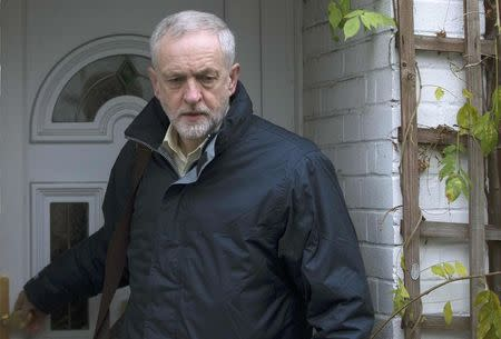 Britain's opposition Labour Party leader Jeremy Corbyn leaves in home in London