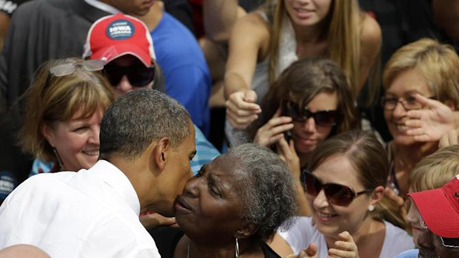 President Barack Obama is kissed by a supporter after speaking at a campaign event at the Living History Farms, Saturday, Sept. 1, 2012, in Urbandale, Iowa. (AP Photo/Pablo Martinez Monsivais)