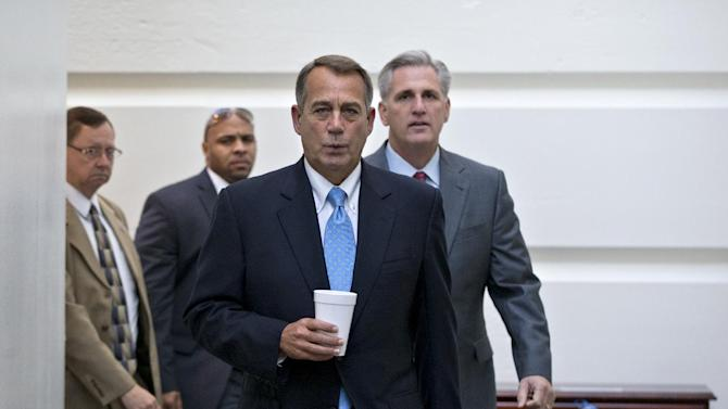 Speaker of the House John Boehner, R-Ohio, with House Majority Whip Kevin McCarthy, R-Calif., right, walks to a meeting of House Republicans at the Capitol in Washington, Tuesday, Oct. 15, 2013, as a partial government shutdown enters its third week. It is not yet clear how Boehner and tea party members in the House majority will respond to the Senate's Democratic and Republican leaders closing in on a deal to avoid an economy-menacing Treasury default and end the partial government shutdown. (AP Photo/J. Scott Applewhite)