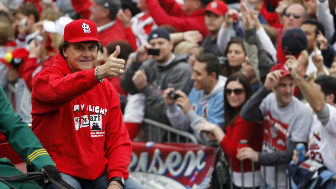 St. Louis Cardinals manager Tony La Russa gives a thumbs-up as he participates in a victory parade for the baseball World Series champions, Sunday, Oct. 30, 2011, in St. Louis. The Cardinals defeated the Texas Rangers in the series. (AP Photo/Jeff Roberson)