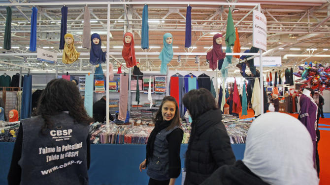 Visitors are seen on the first day of the 30th Annual Meeting of  France's Muslims, at Le Bourget, Europe's largest and most popular Muslim convention, Friday March 29, 2013, on the fringes of the Parisian suburb of Le Bourget.  (AP Photo/Remy de la Mauviniere)