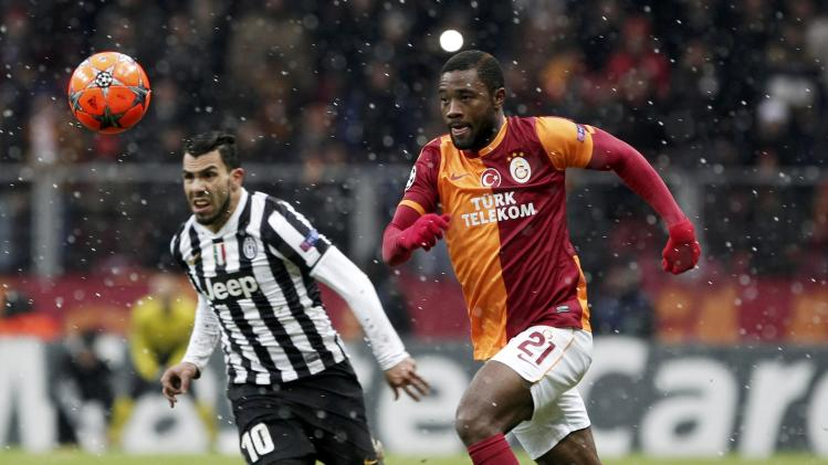 Chedjou of Galatasaray challenges Tevez of Juventus during their Champions League soccer match in Istanbul
