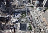 Work continues on the September 11 Memorial and Museum, center, Wednesday, Aug. 24, 2011 in New York. The arrangement of nearly 3,000 names at the World Trade Center memorial is now available as a free iPhone app, memorial officials said Wednesday. (AP Photo/Mark Lennihan)